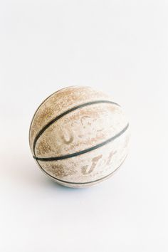 I love basketball. I took a ball with me to college, and every day I would shoot baskets in the outdoor court at Helaman Halls until by the end of the first semester, my ball looked like this one... kind of suede. I still love to shoot baskets. :)