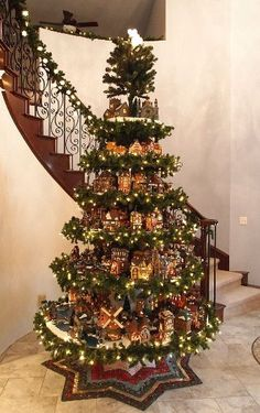 Now this is an idea, add shelves between sections of a tree to display nativity scenes of Christmas village