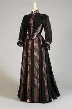 "1889, America - Dress of black lace over pink faille ribbons, label: ""Ghormley/45 E. 19 St., Robes et Manteaux, New York"""