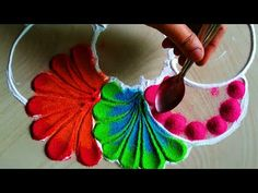 Very beautiful and innovative freehand rangoli using spoon - YouTube