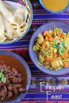 Ethiopian feast, complete with Injera (Ethiopian flat bread), Doro Wat (chicken stew), Mesir Wat (Ethiopian lentils), and an Ethiopian cabbage/carrot/potato side dish