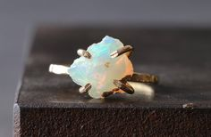 NEW from the winter LACUNA collection simple, earthy, luxe. a natural, raw australian opal is set in handcrafted 14kt gold filled prongs and