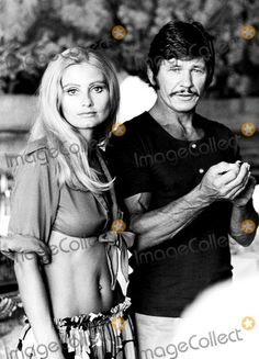 Charles Bronson and wife......Uploaded By www.1stand2ndtimearound.etsy.com