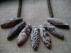 beautiful necklace by Angela Garrod ~ love the simple fabric-like texture on these beads