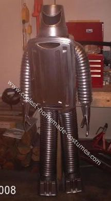 Robot Costume: I made this robot Halloween costume with a plastic case, vent hoses, plastic boxes for feet and plastic jar for the helmet. I took duct tape and glue and