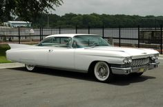 old cadillac cars | White 1960 Cadillac Seville Car Photo | Old Car Pictures. Took my drivers test in the exact same car. Try to parallel that boat.