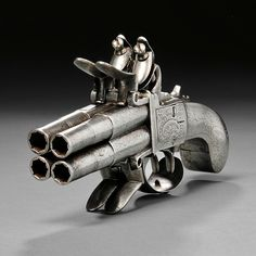 Continental Four-barrel Flintlock Pistol, c. late 18th century, iron butt and frame engraved with foliate designs, four rifled barrels, two hammers, and four steels, overall lg. 7 in.