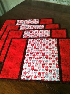 Four Valentine Hearts Colorful Placemats with Multi-Color Hearts and Red Floral Side and Backing Fabric by DesignsbySARose on Etsy Table Runner And Placemats, Quilted Table Runners, Valentine Heart, Valentine Crafts, Valentine Decorations, Panel Quilts, Quilt Blocks, Quilting Projects, Sewing Projects