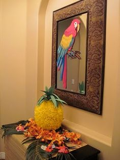 Aloha, party guests. Ideas for decorations, a homemade pineapple pinata, and food.