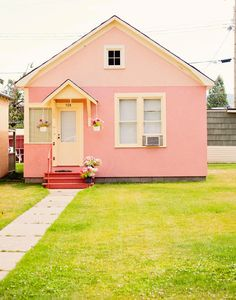 This lovely pink cottage looks like the little house you decided to live in with all your cats one day!