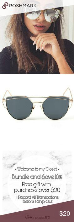 Cat Eye Gold Framed Sunglasses New trendy cat eye sunglasses. Gold frames around silver lenses. Accessories Sunglasses