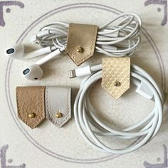 Leather Earphone Cords and Cable Tidy Organisers in Cream, Gold and Nudes, Sets of Two or Four // Stocking fillers for tech geeks by ByLawLondon on Etsy https://www.etsy.com/ca/listing/294673645/leather-earphone-cords-and-cable-tidy