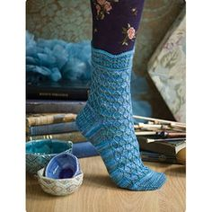 A free pattern from @vogueknitting  in @mountaincolors' Crazyfoot Northwind colorway. Fishnet Cable Sock by Leslie Verts.