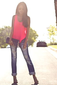 torn, cuffed jean with bright pink top