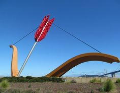 Claus Oldenburg - 'Cupids Span'. Sculpture in SF. The Bay Bridge (2to the right of the sculpture) becomes a light show at night.
