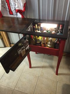 Sewing machine cabinet turned into liquor cabinet.