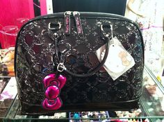 Hello Kitty purse! Love it! Only person that's not a Coach!