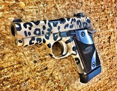 Sig P938 Cerakoted in leopard! Christmas came early for Raynee! Amarillo Custom Cerakote