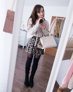 beige lace-up knit sweater, leopard shorts, black suede overknee boots. The Fashion Rose http://www.thefashionrose.com/2017/01/4-ways-to-style-leopard-shorts-for-winter.html