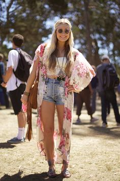 Festival Fashion: long sleeve floral top that hangs long in back paired with top and jean shorts.