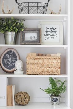 Shelf styling ideas - Greenery and Mementos.  Allow plenty of white space between items.