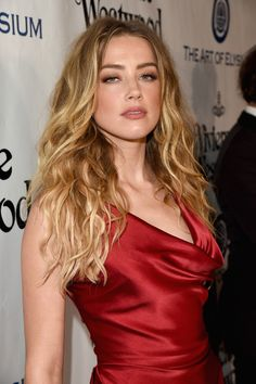 Amber Heard Lookbook: Amber Heard wearing Long Wavy Cut (10 of 40). Amber Heard wore her long locks down with messy-chic waves at the Heaven Gala.