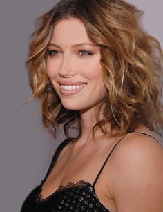 Jessica Biel with short, curly hair.