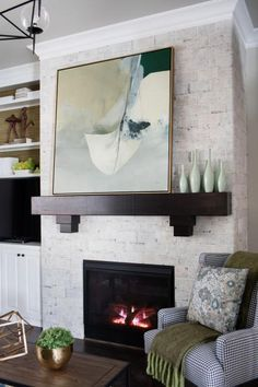 The distinctive thick mantel stands out against the rustic white reclaimed brick fireplace surround.