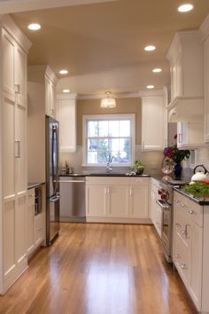 Classic white cabinets with grey quartz countertop.    Neil Kelly Company.