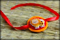 Cute Lion Sticker rakhi for kids to make . We have 15 best ideas to make Rakhi at home for Rakshabandhan - Perfect rakhi ideas for kids to make, rakhi competition, best of waste, simple and handmade with detailed step by step images- ArtsyCraftsyMom Holiday Crafts For Kids, Craft Projects For Kids, Crafts For Kids To Make, Craft Ideas, Rakhi Design, Foam Crafts, Arts And Crafts, Emoji, Rakhi Cards