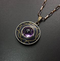 Fine gold inlay on Shakudo pendant featuring a round by KAZNESQ, $230.00