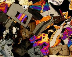 D'Orbigny meteorite thin section viewed through a polarizing microscope
