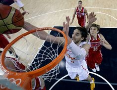 Spain's Pau Gasol scores as Russia's Andrei Kirilenko (15) defends during a semifinal men's basketball game at the 2012 Summer Olympics, Friday, Aug. 10, 2012, in London. (AP Photo/Eric Gay, pool)