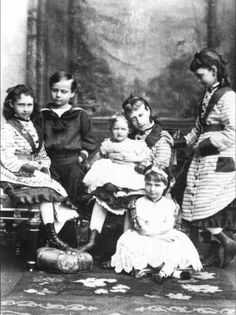 The Hesse children, 1876 - Alix sits on the floor, Victoria holds baby May, Ernst and Irene sit to the left, Ella looks on