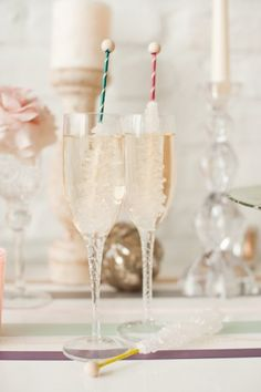 Ring in the New Year on an extra sweet note with these wonderful glasses of Rock Candy Swizzle Stick Champagne. #champagne #candy #rock #food #drinks #wedding #New #Years #holidays #party #entertaining