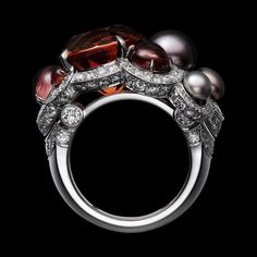 """CARTIER. """"Automne"""" Ring - white gold, one 12.77-carat cushion-shaped brown orange tourmaline, four button-shaped gray natural pearls totaling 19.12 grains, three round-shaped cabochon-cut pinkish brown garnets totaling 4.09 carats, round-shaped cabochon-cut orange sapphires, brilliant-cut diamonds. #Cartier #ÉtourdissantCartier #2015 #HauteJoaillerie #HighJewellery #FineJewelry #Tourmaline #NaturalPearl #Garnet #OrangeSapphire #Diamond Cartier Jewelry, Cartier Rings, Jewelry Watches, Lotus Jewelry, Orange Sapphire, White Gold Rings, Beautiful Rings, Garnet, Jewerly"""