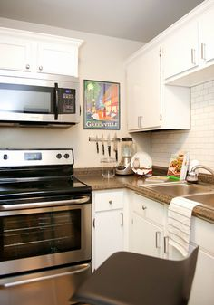 small kitchen design by the decorologist - white subway tile and crown moulding on cabinets are cost-effective upgrades!