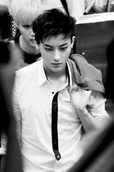 I don't why but he Kinda looks lifeless in this picture cheer up Tao we love you!