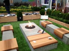 Wood and Concrete outdoor benches with hidden outdoor lighting. See it? #landscapelighting - Outdoor Ideas