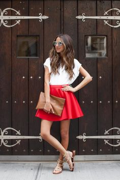 Something Red: Arielle Nachmani of Something Navy wears a red neoprene skirt by Sam Edelman Apparel F/W 14