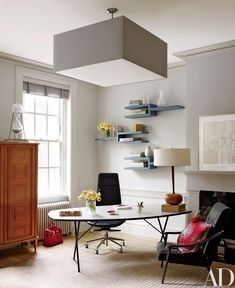 A Piet Boon ceiling light from Twentieth overlooks the study | archdigest.com