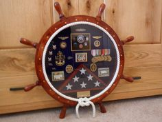 Navy Ship's Wheel Shadow Box I love this idea for after he retired to store his medals and ribbons -for gma Retirement Parties, Retirement Gifts, Flag Display Case, Display Cases, Military Shadow Box, Navy Military, Military Gifts, Military Memorabilia, Military Retirement