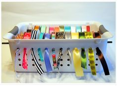 Genius! Look at this smart ribbon organizer from Spunky Junky. And it only cost $5! Could be less than that if you already have one of these containers laying around :)