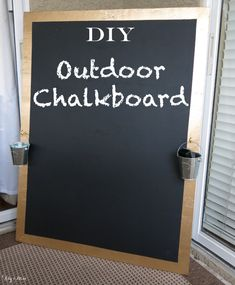 Keep the chalk mess in the backyard w/ this DIY outdoor chalkboard. Make it fancy with gold borders (spray paint). Screw on some brass hooks and hang $1 tin pails to hold the chalk and eraser!