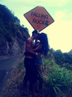 falling in love rocks , road sign ...