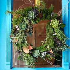 "This wreath is made from ""bits and bits"" of items picked up while walking after a big storm. Pine, fir, rosemary, magnolia leaves, succulents, and berries are wrapped into the wreath."