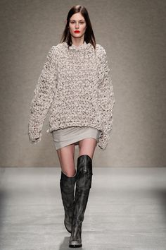 A. F. Vandevorst fall '14: oversized loose weave sweater with distressed tall boots