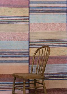 """Back in the day, you might put some """"catalogne de plancher"""" on the walls to hang them up (or maybe keep out the cold?) but i guess someone liked the looks alone = """"Catalogne Wallpaper"""" Build A Wall, Decoration, Rugs On Carpet, Dining Chairs, Weaving, Wall Decor, Inspiration, Antiques, Wallpaper"""