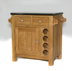 401 - This handy little island unit has drawers  and a cupboard that open from both sides and space for 8 wine bottles.