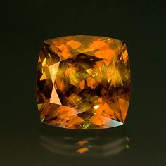 Golden brown sphene. This stone weighs 40.33 carats and measures 20.03 x 20.05 x 12.86 mm